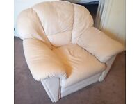 Beige leather armchair in a good condition
