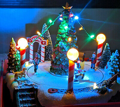 Animated Christmas Village Skaters Rotate Around Holiday Tree LED Lights Music