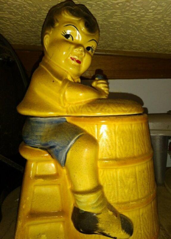 Antique Boy churning butter cookie jar