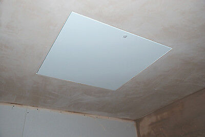 Metal door beaded frame installed in a ceiling with the frame plastered over