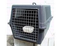PLASTIC DOG TRAVEL CRATE, used. Exterior h46 x w49 x d69cm max. COLLECTION ONLY