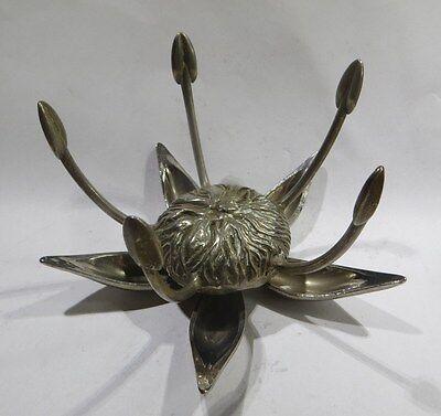 Objet en métal blanc et inox  – en forme de fleur stylisée  -  Quelqu'un peut-il