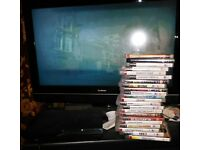 PS3 Slim + 22 games, controller and cables