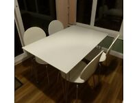 White dining table with chrome legs and 4 chairs (all from the House range at John Lewis)