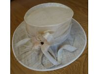 M&S Cream hat small to medium with feather features and bow.