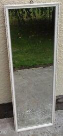 Long dressing mirror, white, patterned wooden frame.