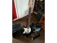 Electric guitar and two amps plus stand