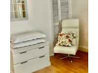 £20 must go!lovely,stylish and swivelling,ivory colour faux leather armchair