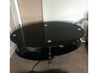 Three tier coffee table with black glass