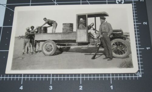 Men Unload OIL BARREL Delivery Truck Man w/ GUN Guard Gas Vintage Snapshot PHOTO