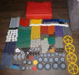 K'Nex Construction Kit - 1111 pieces in a red carry case box, includes wheels, rods, connectors...