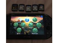 PS Vita with 5 games, case and 8gb memory card