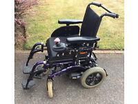 Purple Invacare Mirage Electric Wheelchair