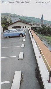 1983 -- TOIT DE LA SALLE POLYVALENTE MARCHAMPT 3E654 - France - 1983 -- TOIT DE LA SALLE POLYVALENTE MARCHAMPT 3E654 il ne s'agit pas d'une carte postale , mais d'un beau document paru dans la rare LES TOITS DE FRANCE EN 1983 le document GARANTI D'EPOQUE est en tres bon état et présenté sur carton d'encadr - France