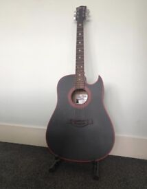 Black acoustic guitar.