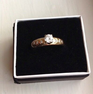 1/4 Carat Diamond 14 K Gold Ring 3 small diamonds on each side smaller size for sale  Shipping to Canada