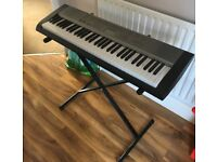 Casio LK-125 Keyboard and stand