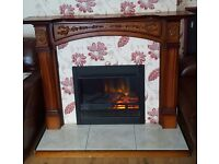 Fire surround including hearth and electric fire