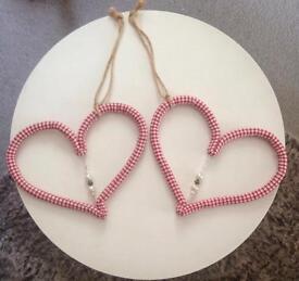 Matching hanging hearts