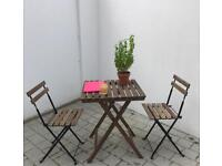 Outdoor wooden bistro table and chairs