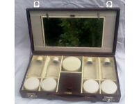 A 1920'S BURGUNDY LEATHER ,TRAVELLING VANITY CASE, CONDIMENT SET BY MAYLOR LONDON,