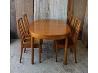 Nathan furniture teak extending dining table and four chairs