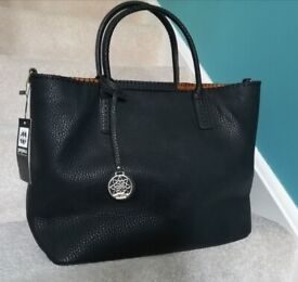 Large black tote in faux leather like material, internal zip compartme