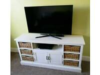 Distressed paint tv unit with wicker baskets