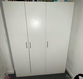 Two IKEA white wardrobes