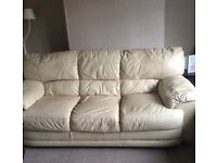 Cream leather three seater sofa