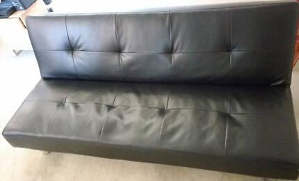 Black leather sofa cum bed
