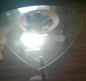 Glass coffee table with silver legs , bargain