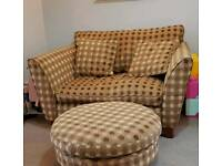 Green spotted M&S love seat and footstool