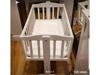 Small rocking crib and matress