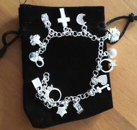 100% sterling silver charm bracelet