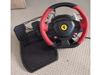 Thrustmaster 458 Spider Racing Wheel and pedals.