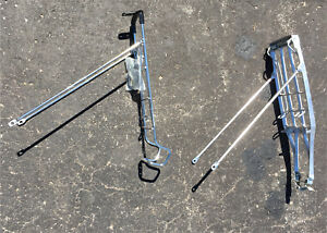 Two bike rear racks with spring