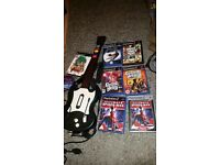 slim playstation 2, 8 games,guitar controller & a wireless controller