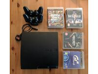 PS3 (320gb slim) w/ 2 controllers & 12 games