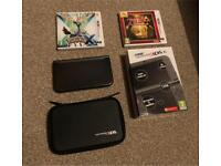 New Nintendo 3DS XL with games and accessories
