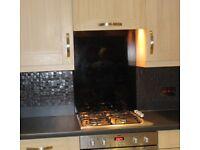 Black glass heatproof hob splash back 600mm wide