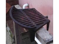 Cast iron fire basket/grate.