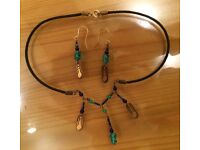 Hand made Necklace and Earrings set. Bead and metal with Goddess design