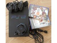 PLAY STATION 2 WITH EYE TOY, CONTROLLER AND 2 GAMES