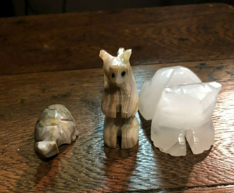 carved stone animals squirrel turtle frog