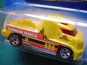 Hotwheels-2010-Rapid-Response-YELLOW-Ambulance-SEE-THRU-CARGO-18-44-New-SEALED