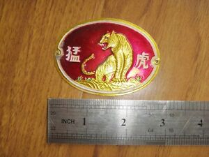 a-China-1980s-bike-Head-badge-tiger-Unused