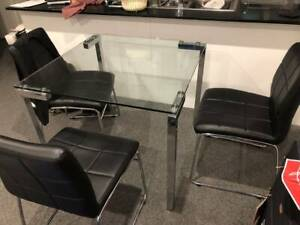 4 seater glass dining room table with 3 dining chairs