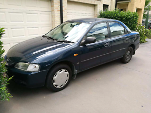 Ford Laser 1998 1.8L 6 months rego economical Blue Rooty Hill Blacktown Area Preview