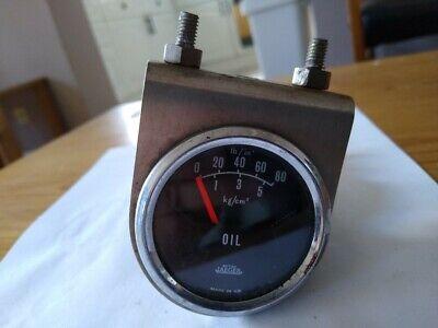 Jaeger 52mm oil pressure gauge with mounting bracket.  Classic mini etc